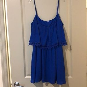 Beautiful, blue dress with adjustable straps.